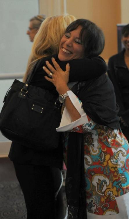 cantor Debbi Ballard at the Shema Koleinu High Holy Days - Jewish New Year services 2017/5778, hugging a member of her community